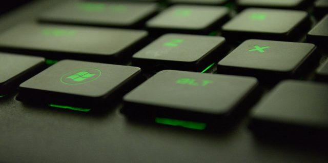 close up photography of black and green computer keyboard keys